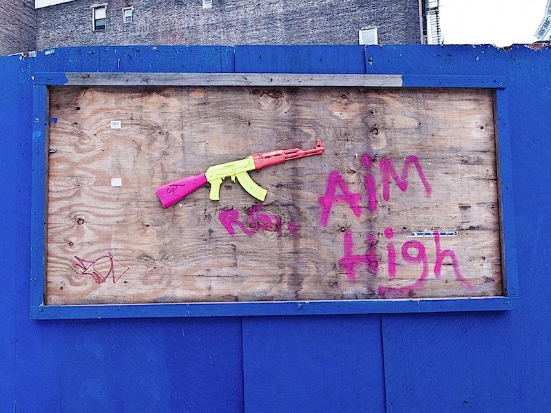 aim_high_toy_ak_47_street_art_soho_nyc.jpg