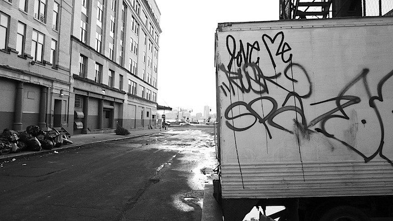 love me street art graffiti spray painted on a truck in the meatpacking district of NYC