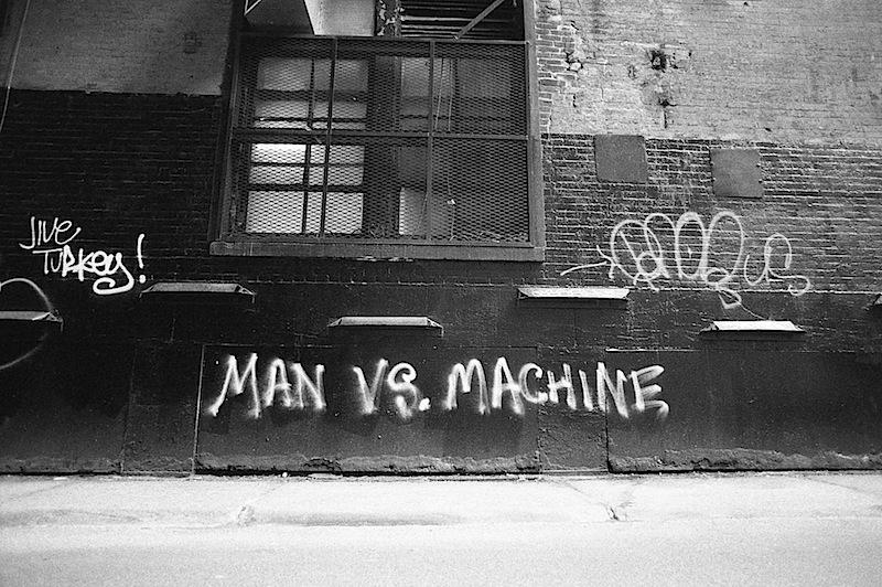 man_vs_machine_graffiti_found_in_nyc.jpg