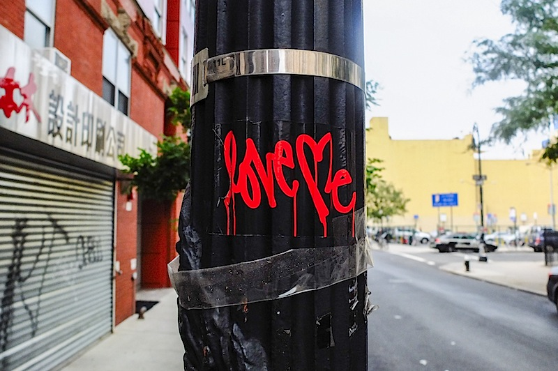 a classic red and black love me sticker found in the lower east of NYC